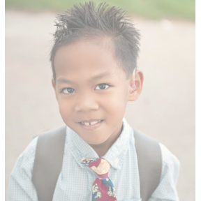 young deaf boy with hearing aid