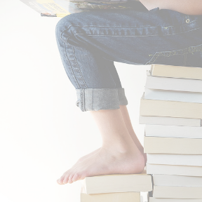 girl reading while sitting on a stack of books