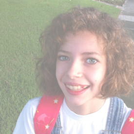 elementary age girl with curly hair